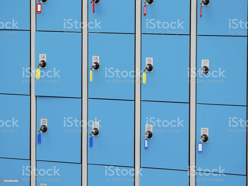 closeup blue deposite boxes with keys. left luggage stock photo