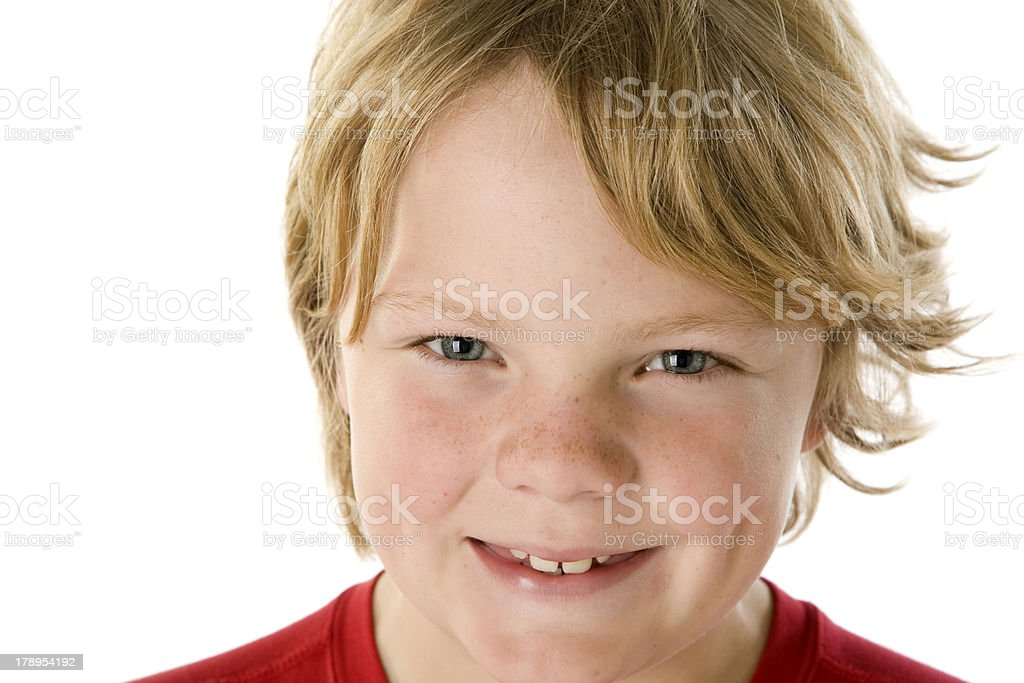 Closeup Boy with Great Smile Freckles and Messy Hair stock photo
