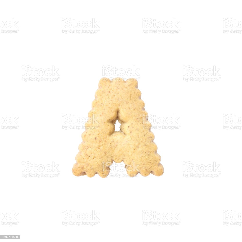Closeup brown biscuit in A english alphabet isolated on white background with clipping path stock photo