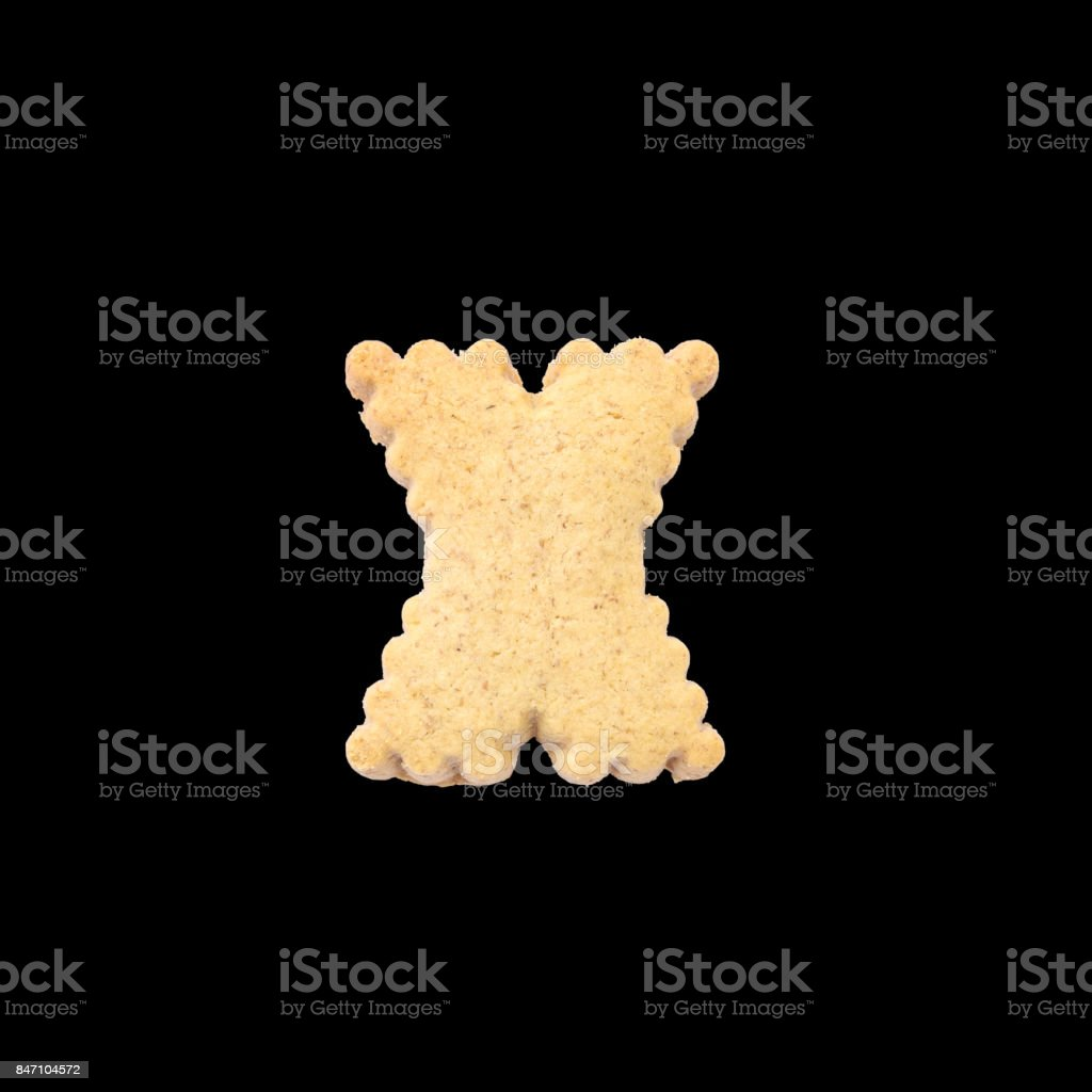 Closeup brown biscuit in X english alphabet isolated on black background with clipping path stock photo