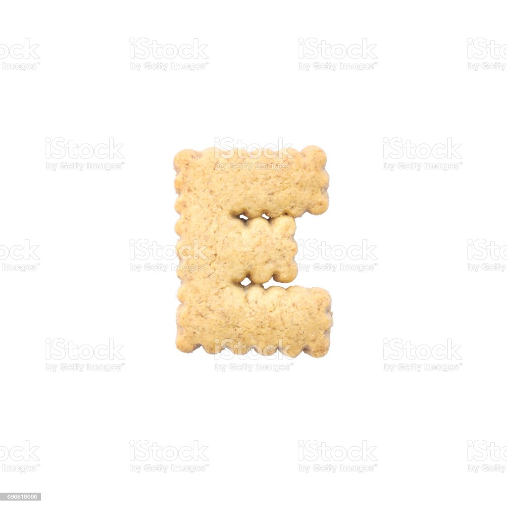 Closeup brown cookie in E english alphabet isolated on white background with clipping path stock photo