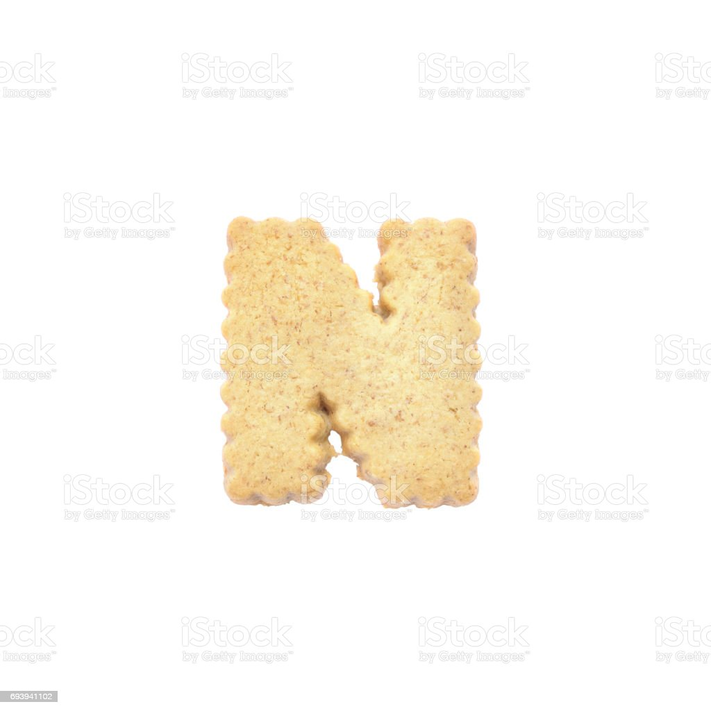 Closeup brown cookie in N english alphabet isolated on white background with clipping path stock photo