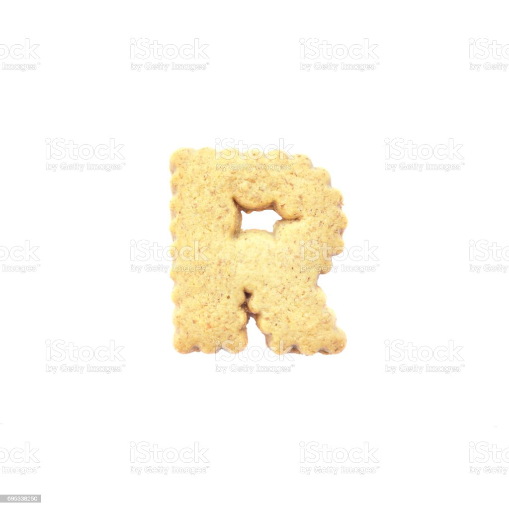 Closeup brown cookie in R english alphabet isolated on white background with clipping path stock photo