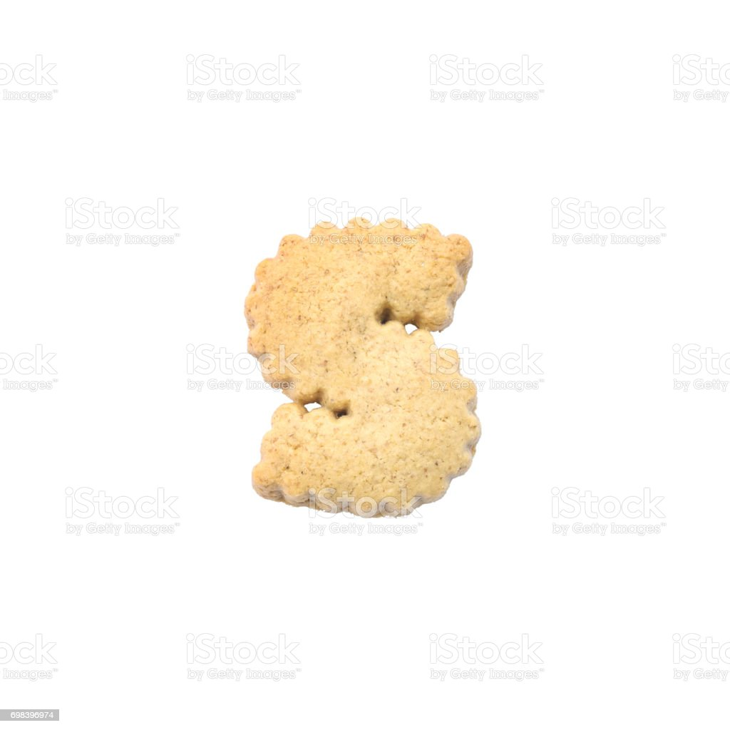 Closeup brown cookie in S english alphabet isolated on white background with clipping path stock photo