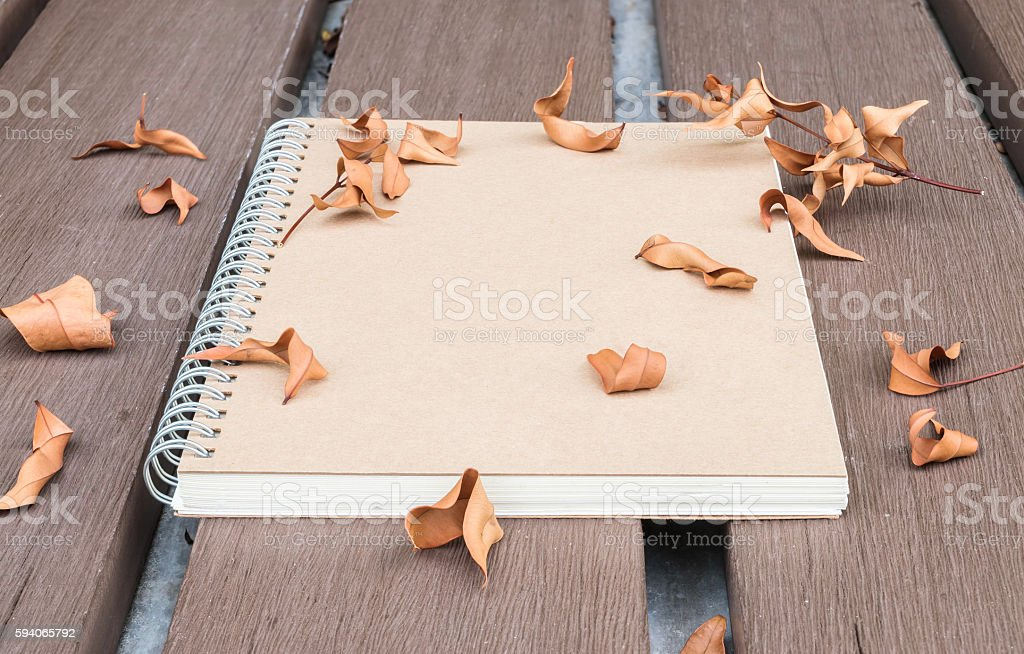 Closeup brown note book on wooden table in the garden stock photo