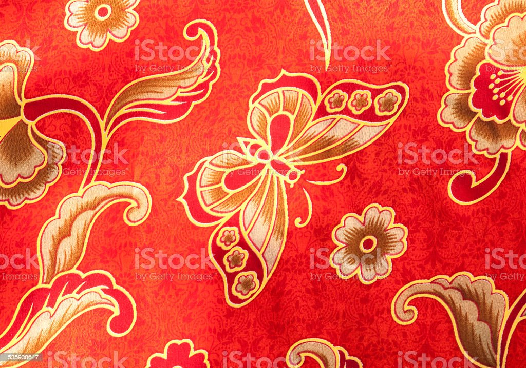 Close-up Butterfly pattern on red batik royalty-free stock photo