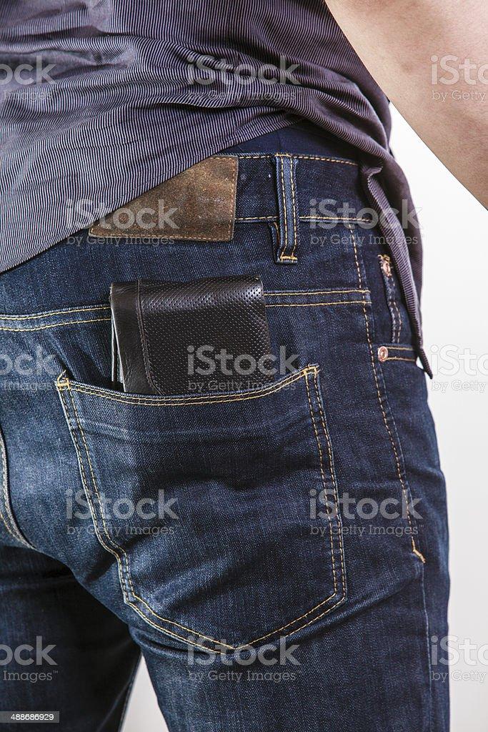 Closeup. Careless man with wallet on back pocket. Theft. stock photo