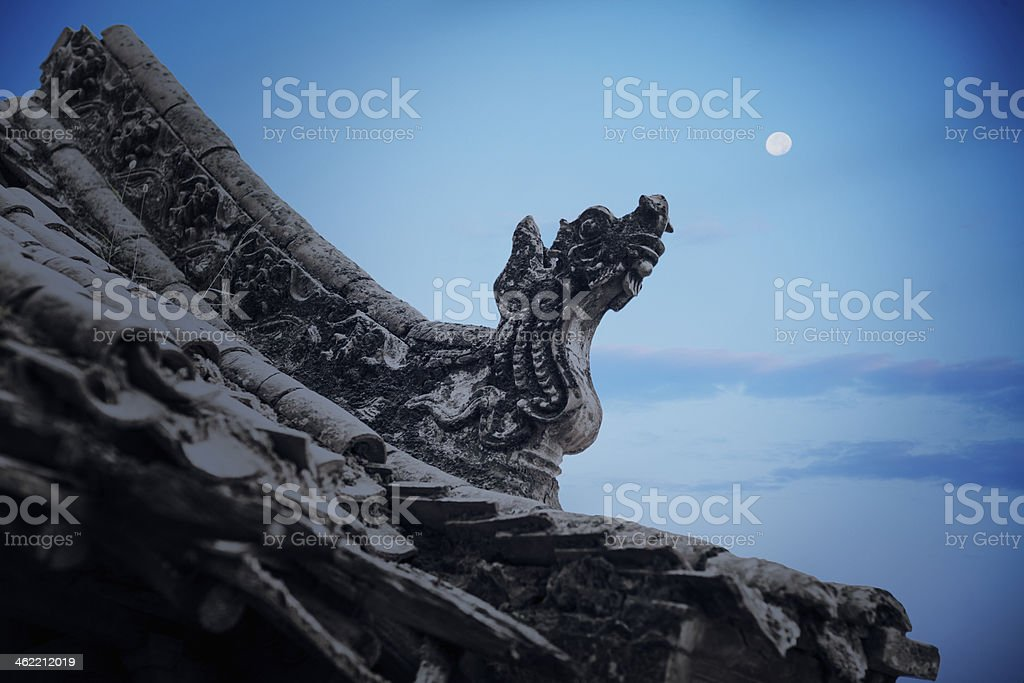 Close-up - carvings on roof of the pagoda, dusk royalty-free stock photo