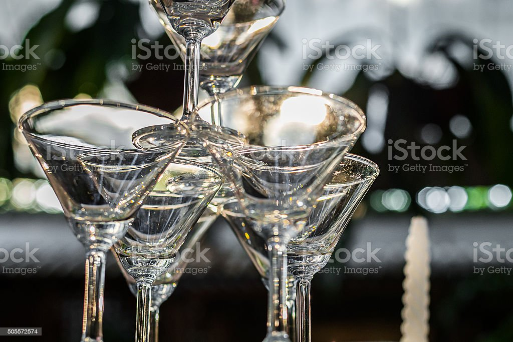 Closeup champagne glasses setting in pyramid shape for wedding ceremony stock photo