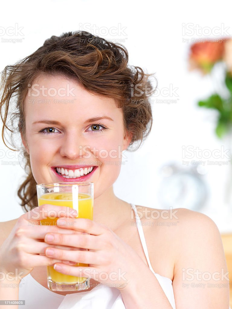 Close-up cheerful girl drinking juice royalty-free stock photo