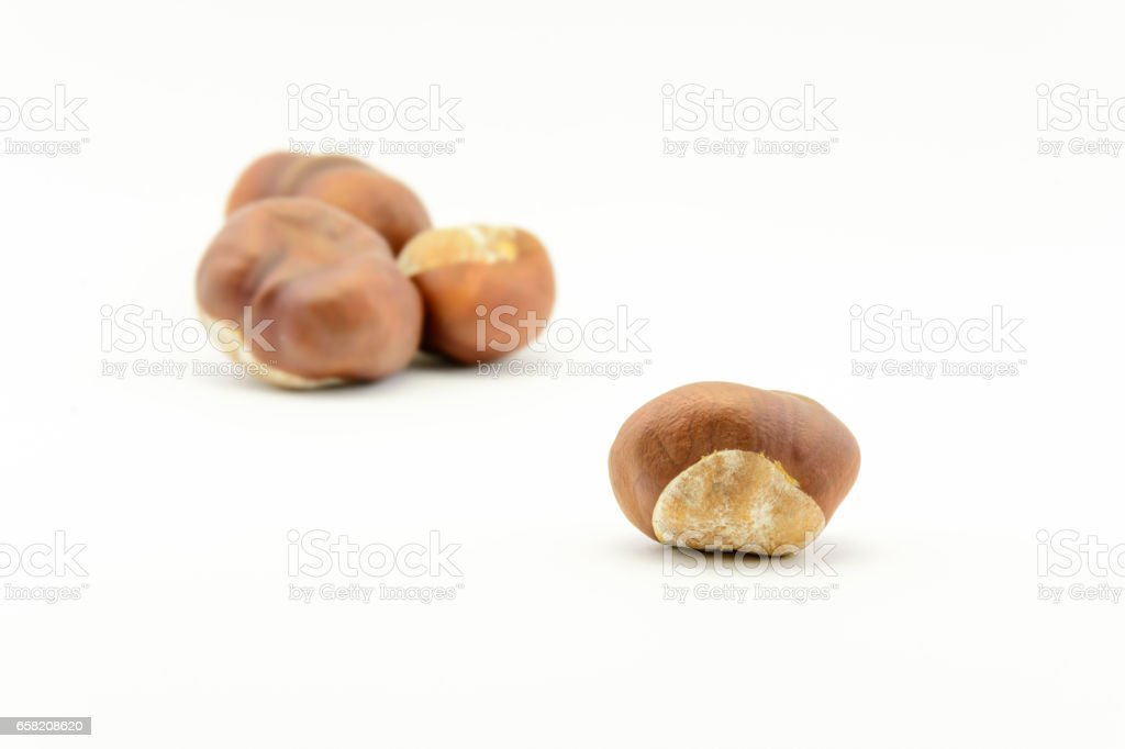 Closeup chestnuts isolated on white background stock photo