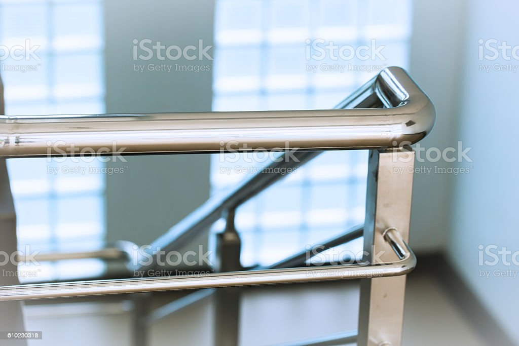 Closeup chrome stainless steel Ladder or Stair Railing stock photo