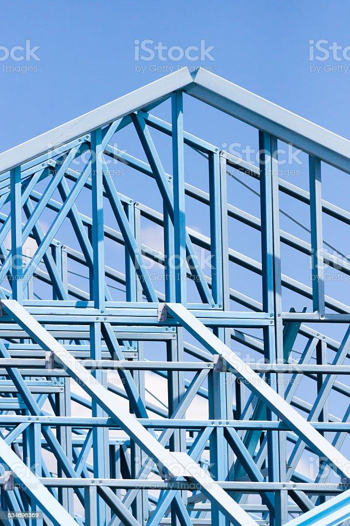 Closeup construction blue steel frame against blue sky, copy space stock photo