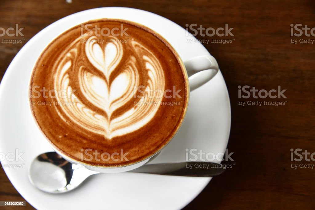 closeup cup of coffee latte art and mocha on old brown wooden background square frame image. stock photo