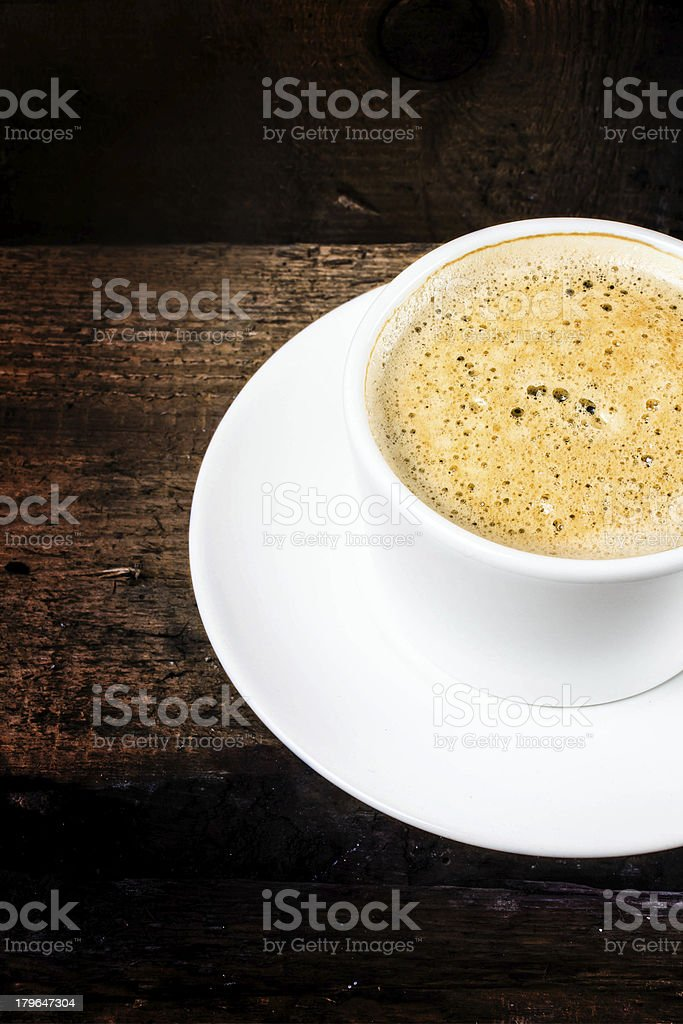Closeup cup of espresso on old wooden table background royalty-free stock photo