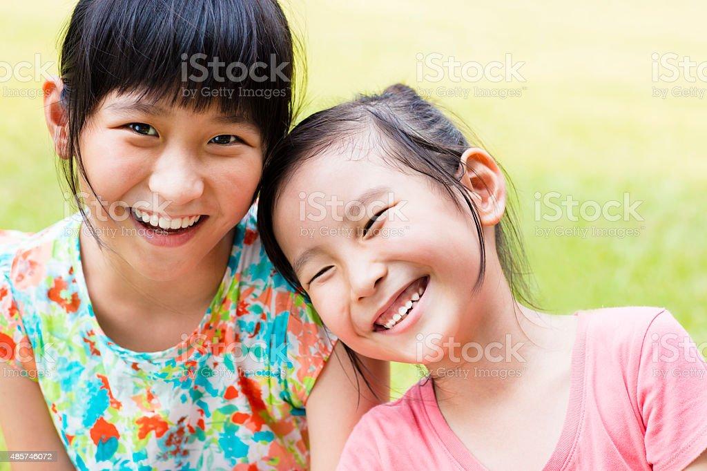 closeup Cute little girls on the grass stock photo