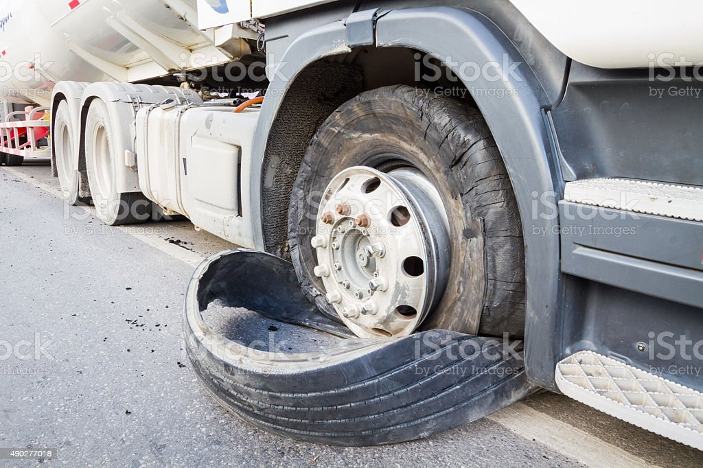 closeup damaged 18 wheeler semi truck burst tires stock photo