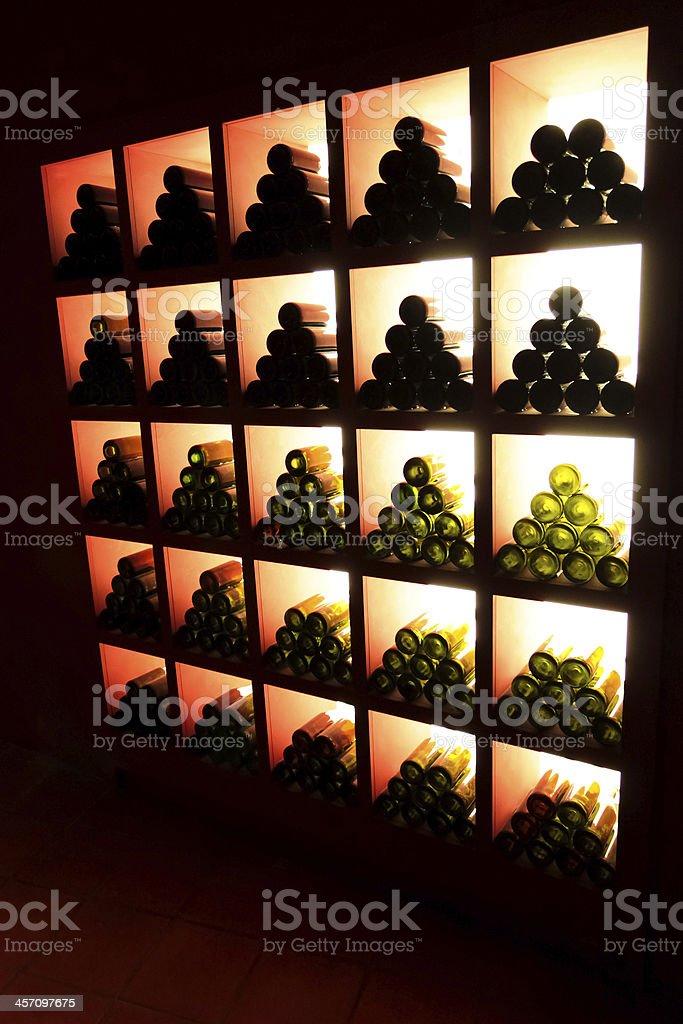 Closeup dark shot of wineshelf stock photo