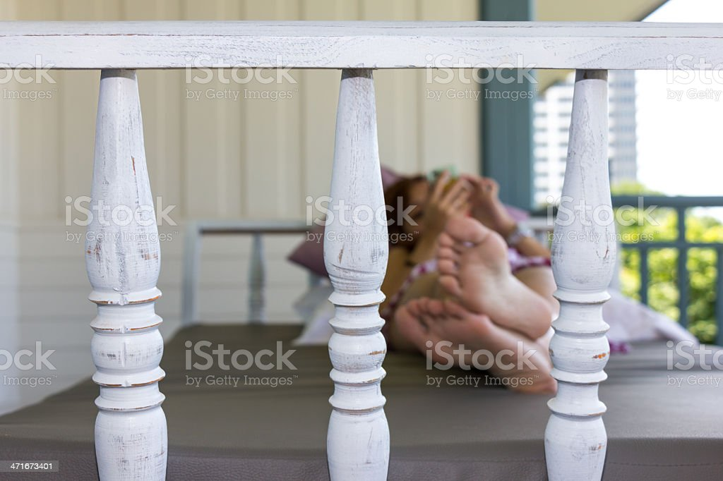 Closeup daybed at balcony and woman background royalty-free stock photo
