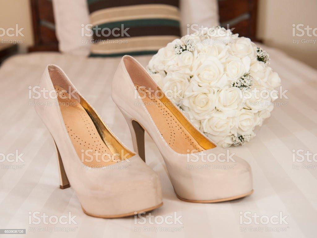 Closeup detail of bridal stiletto shoes stock photo