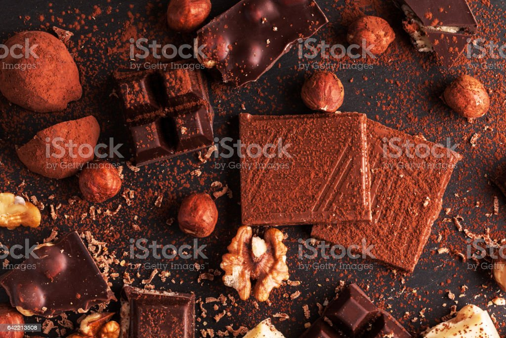 Closeup detail of chocolate parts on white background. stock photo