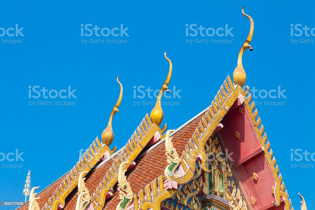 closeup detail of ornately decorated temple roof in bangkok stock photo