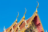 closeup detail of ornately decorated temple roof in bangkok