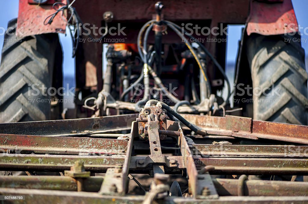 Close-up detail of tractor or machine harvesting the field stock photo