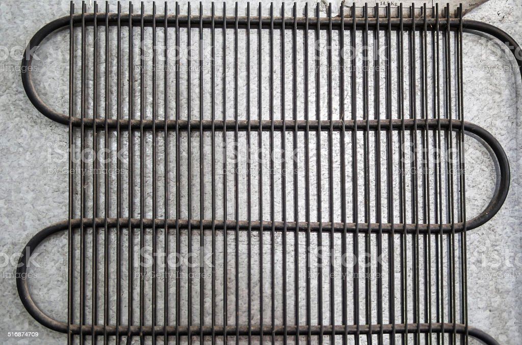 Closeup details of old external air-cooled condenser in water cooler stock photo