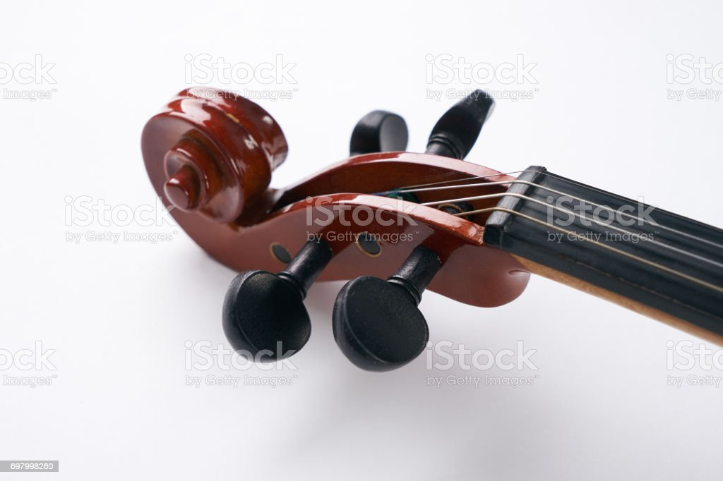 Close-up details of Violin head isolated on white background with copy space. stock photo
