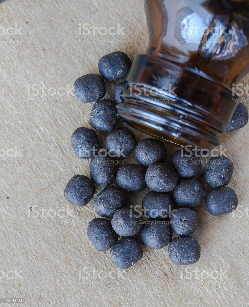 Closeup drug black pigment dislodged from the bottle stock photo