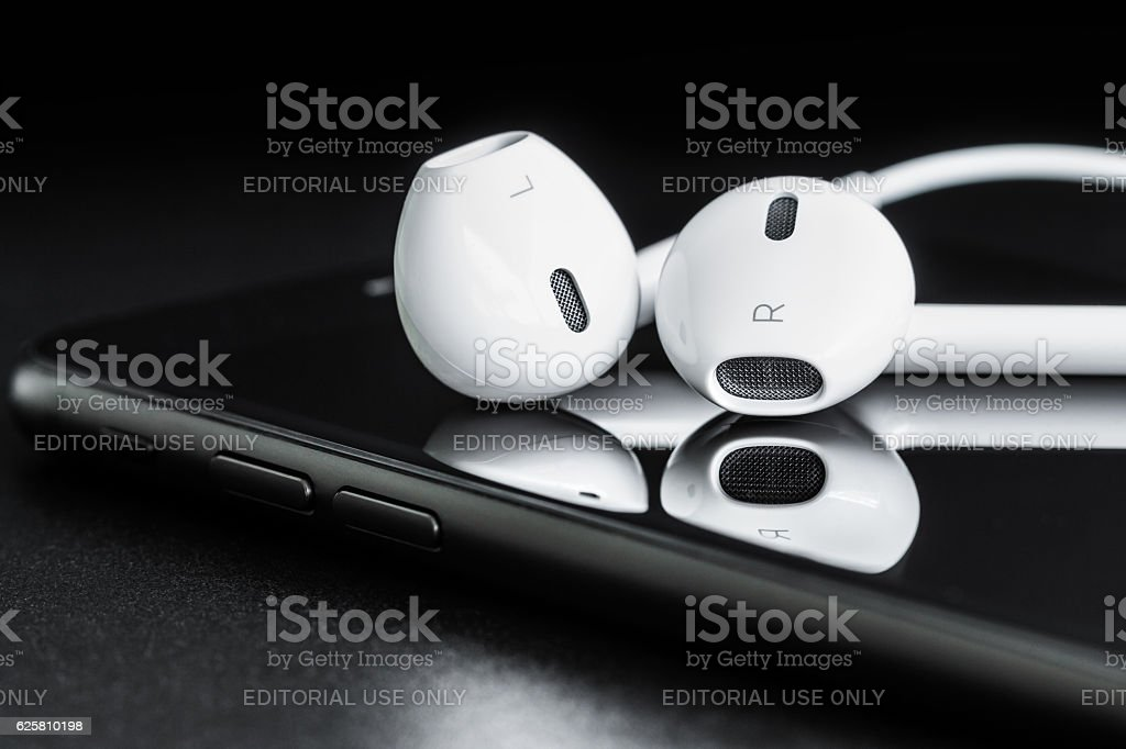 Close-up earpods on iphone 7 stock photo