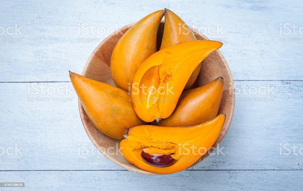 Closeup egg fruit in wooden bowl stock photo
