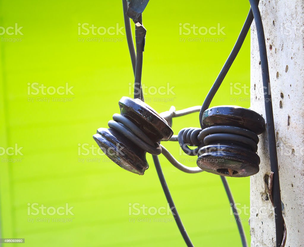 Closeup electrical insulator on the electricity post stock photo