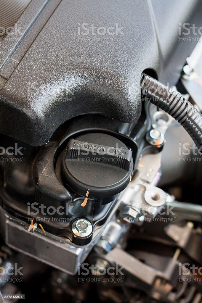 closeup engine oil cap in engine stock photo