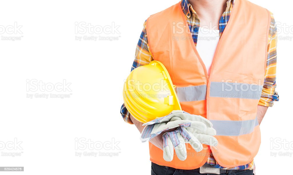 Closeup engineer holding helmet and wearing vest and gloves stock photo