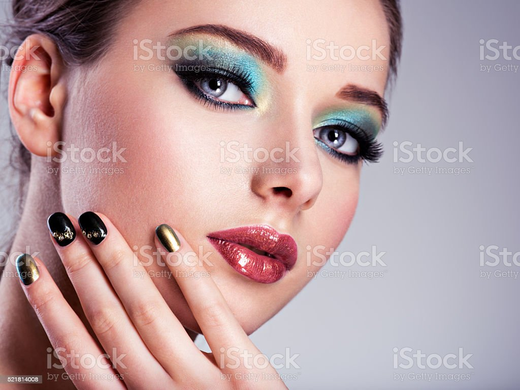 Close-up face of  a Beautiul woman with green creative stock photo