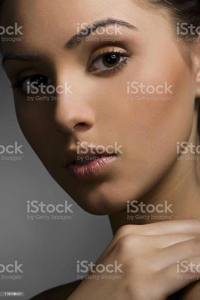 Close-up face of beautiful caucasian brunet woman with brown eyes royalty-free stock photo
