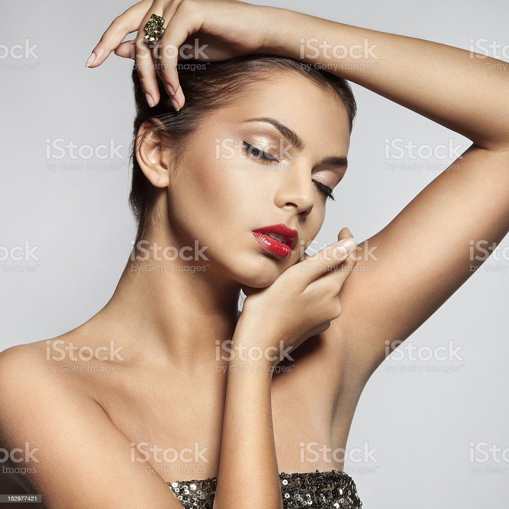 Close-up face of beautiful caucasian brunet woman with ring. royalty-free stock photo