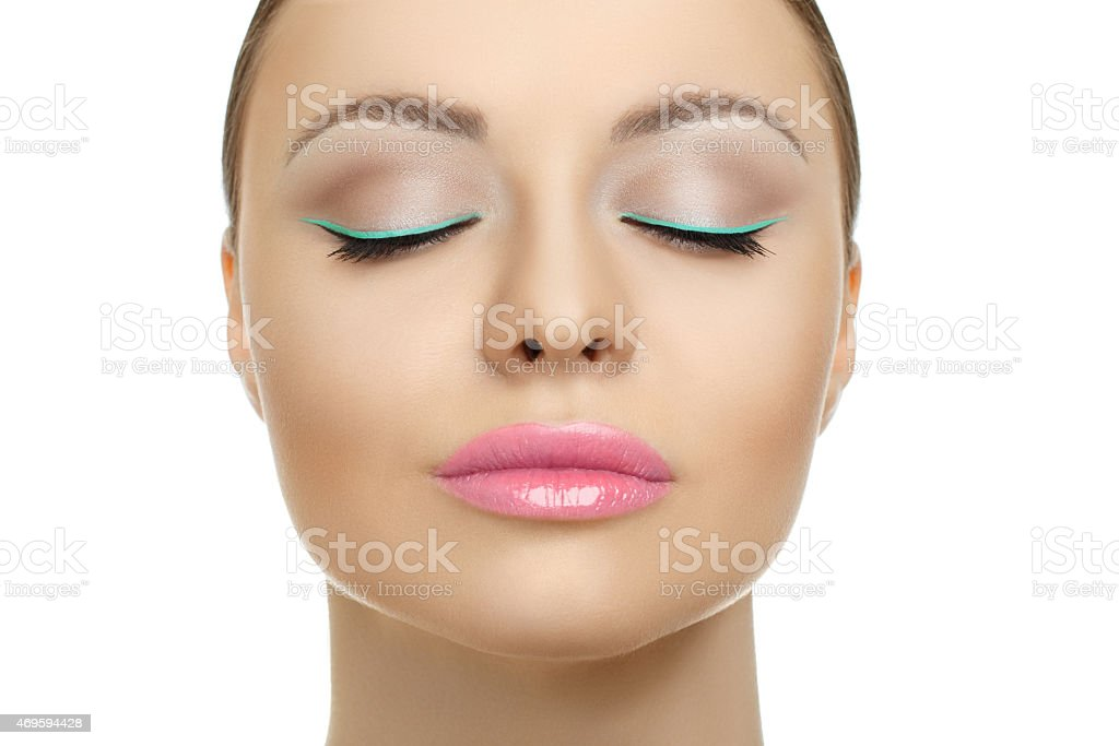 Closeup face of beauty woman with blue eyeliner make-up stock photo