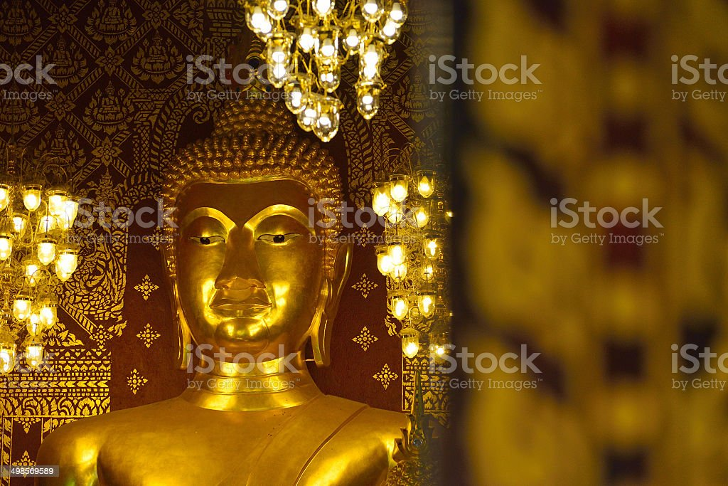 closeup face of buddha statue in temple buddhism royalty-free stock photo