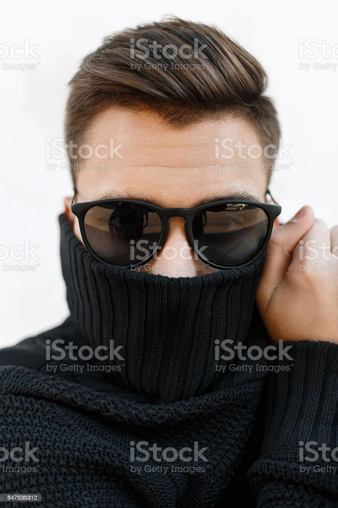 Close-up fashion portrait of a young handsome man stock photo