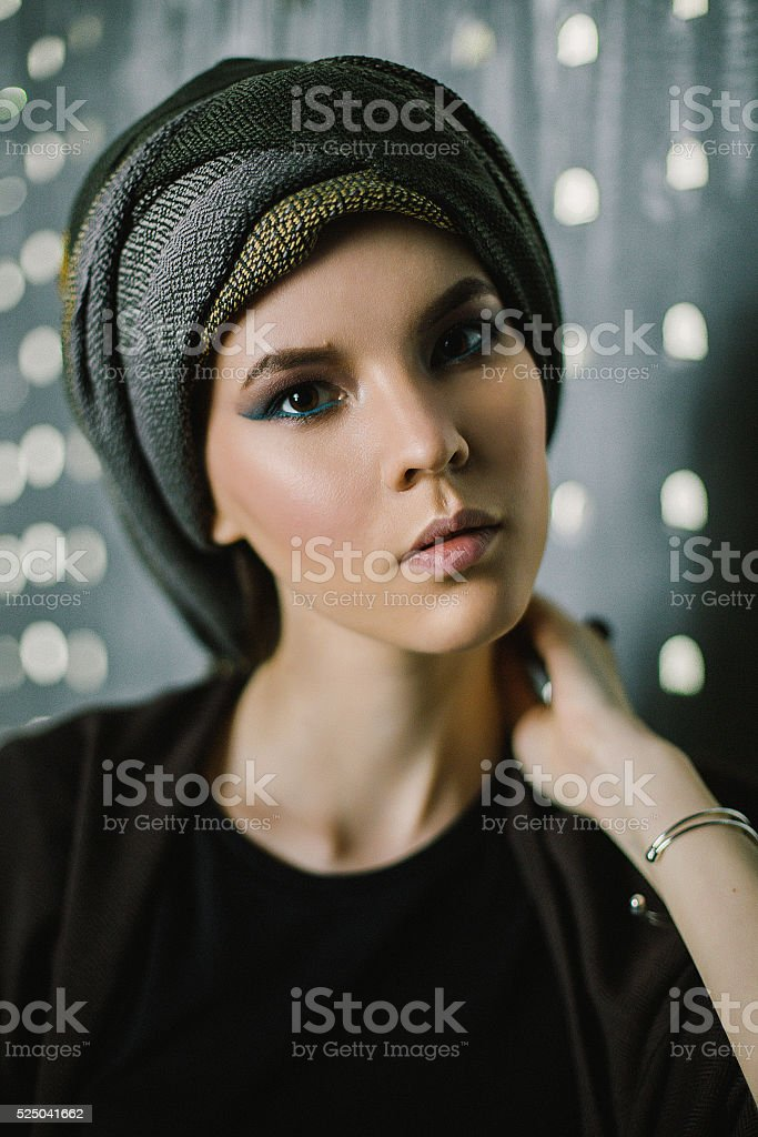 Close-up fashion portrait of young eatern woman in turban stock photo