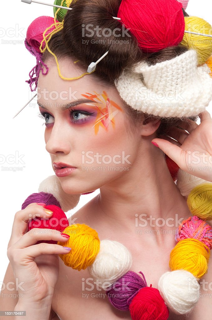 Closeup fashion woman with color face art in knitting style royalty-free stock photo