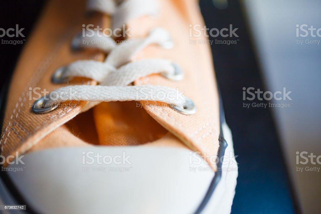 Closeup fashionable sneakers on shop shelf stock photo