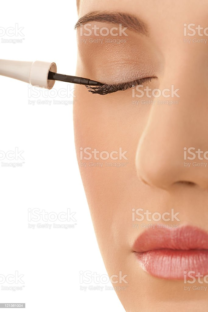 Close-up female applying eye liner royalty-free stock photo