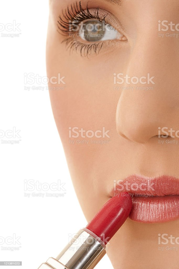 Close-up female applying lipstick royalty-free stock photo