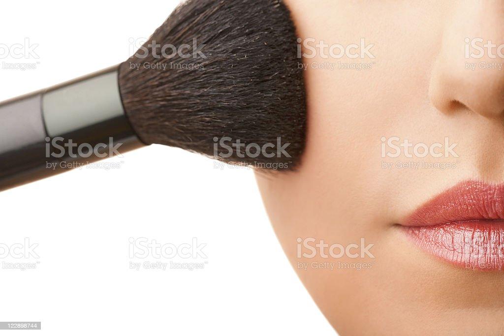Close-up female applying make-up royalty-free stock photo