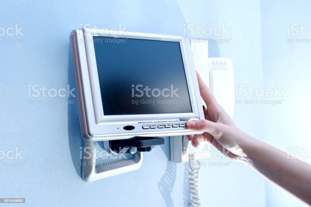 Close-up female hand setting security alarm system. stock photo