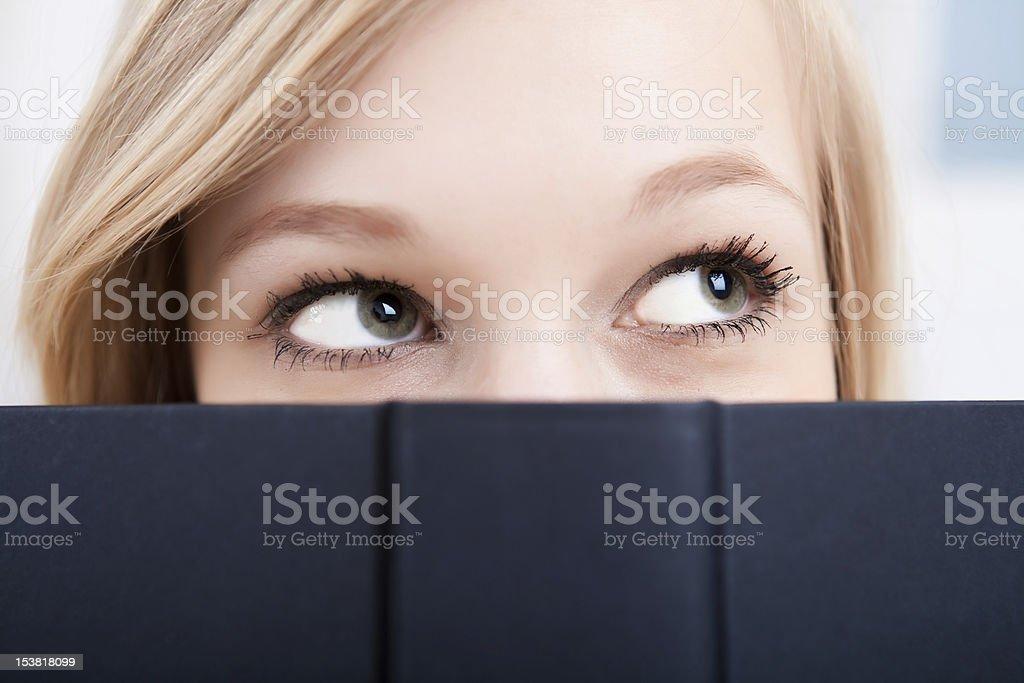 Close-up female student reading royalty-free stock photo